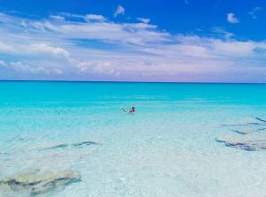 Woman swimming in Bimini Bahamas