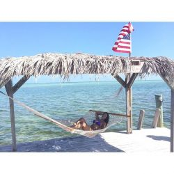 A photo of a Girl In a hammock on a dock on Islamorada