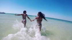 A picture of Two girls running through shallow water on Islamorada