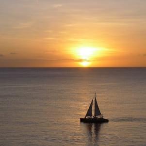 A sailboat at sunset in Aruba