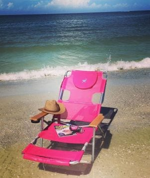A picture of a pink beach chair, a fishy magazine and a high energy drink  on Fort Myers Beach