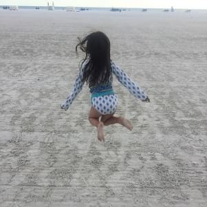Jumping for joy on Fort Myers Beach Florida
