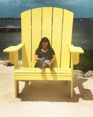 Relaxing on a yellow char in Key Largo