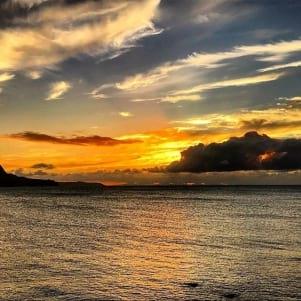 Dramatic lava orange sunset above Molokai