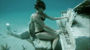 Playing piano underwater